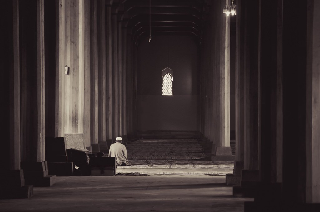 """""""Muslim Praying by Himself between 370 Wooden Pillars"""" by terbeck is licensed under CC BY-NC-SA 2.0"""